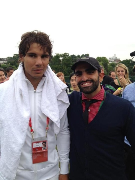 Rafael Nadal and myself back during Wimbledon 2012. The woman behind me must really think that he is yummy...